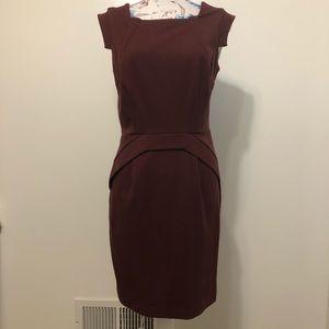 Jennifer Lopez dark red form fitting warm dress 6